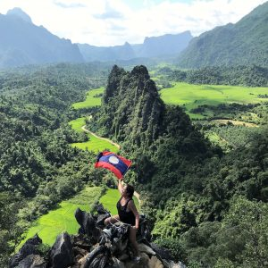 Mountains, Forest, Trees, A woman holding a Laos Flag