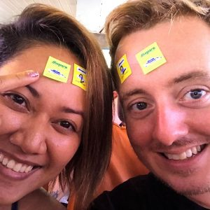 Two people smiling with ferry stickers on their forehead