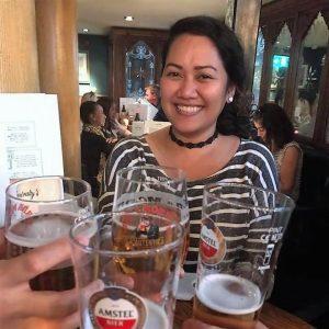 Inside a pub in London, People drinking, Beer inside a glass