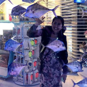 Inside a mall in Dubai, Items for sale, Fishes, Girl smiling,