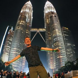 A man posing, Petronas Towers In Malaysia, trees, night sky