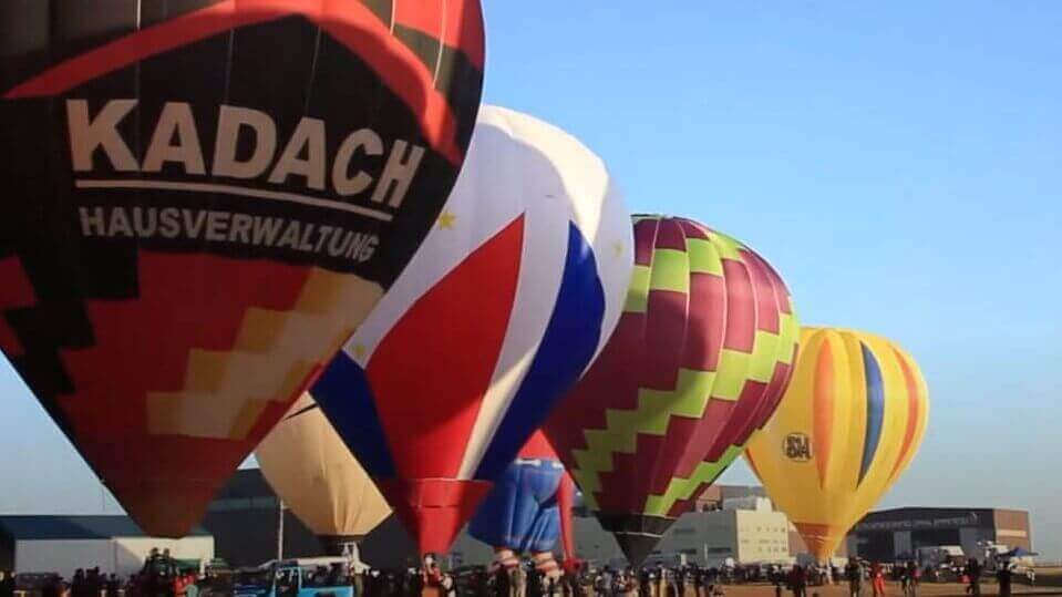 Hot Air Balloons, Blue Sky, People gathered to watch