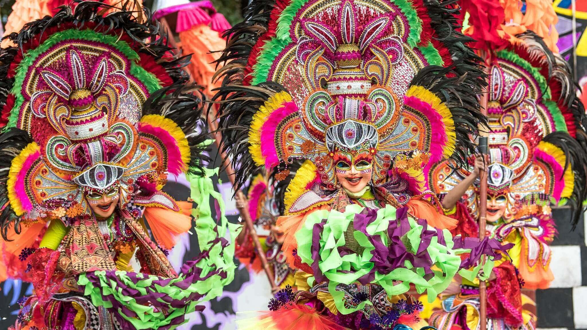 People wearing colorful costumes while parading on the street, Festival. street dancing