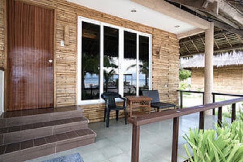 Kota Room Front View, Chairs and Table, Plants, Balcony,Sliding Window,