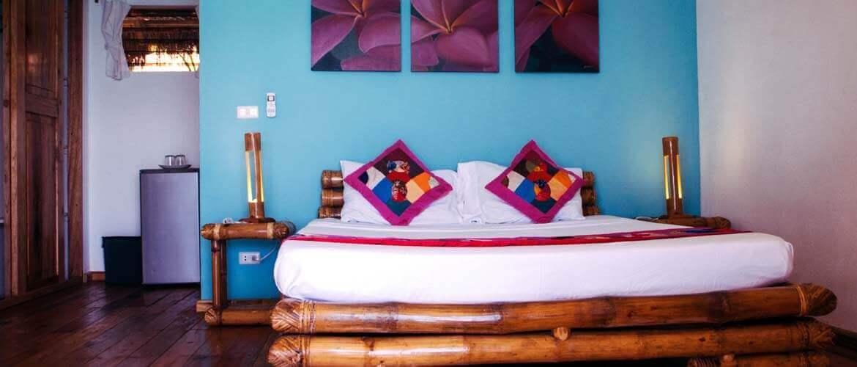 Bedroom. Bed, Nightsand, Lamp, Picture Frames, Mini Refrigerator, Garbage Bin