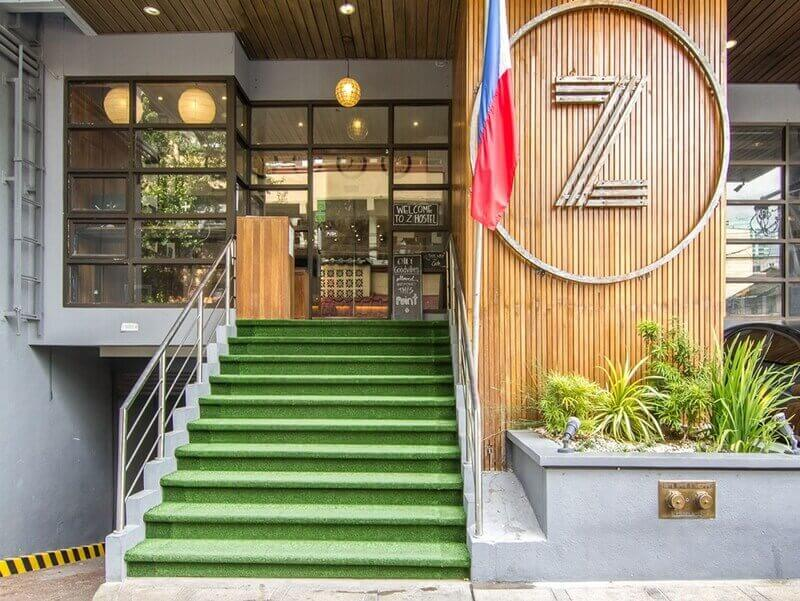 Z Hostel Front View, Stairs, Lights, Plants, Philippines Flag