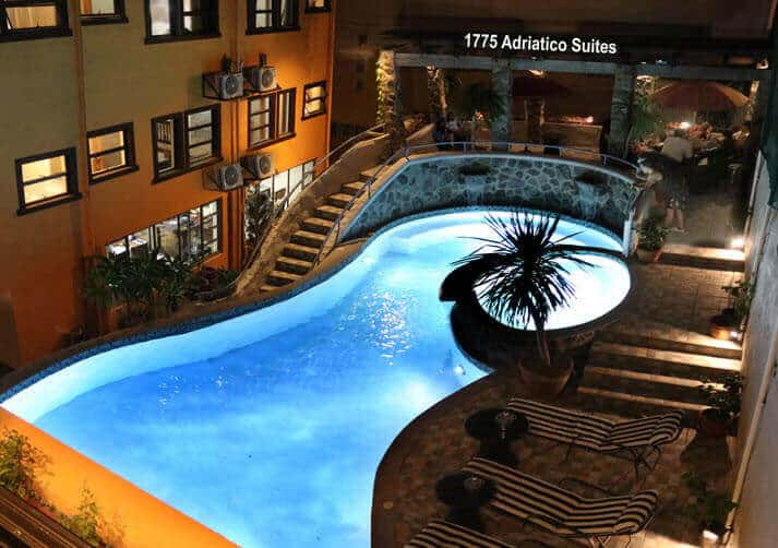 Adriatico Suites Pool Area, Swimming Pool, Beach Chairs, Plants, Palm Trees