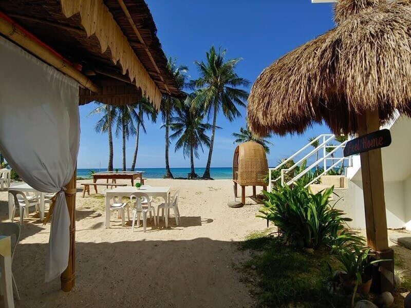 Beach house, cottage, Blue sky, coconut trees, chairs and tables, white sand, clear blue ocean