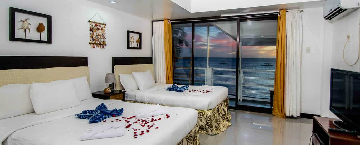 Beach, Beds, Nightstand, lamp, Picure Frame, curtains Sliding Door, Balcony, Sunset, TV, Aircon, Coconut Trees,