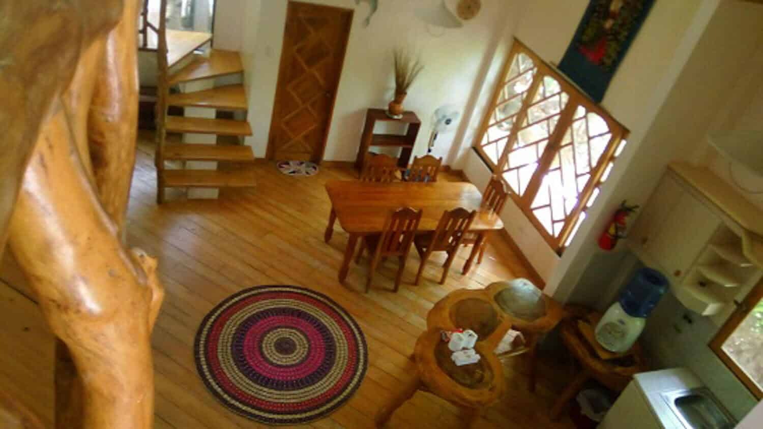 Living room, Stairs, Chairs and Tables, Mat, Sink,WaterDispenser, Cabinets, Windows , Decorations,