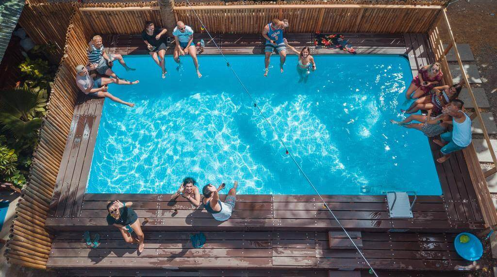 Swimming Pool, People Enjoying, Bamboo Fence,Trees