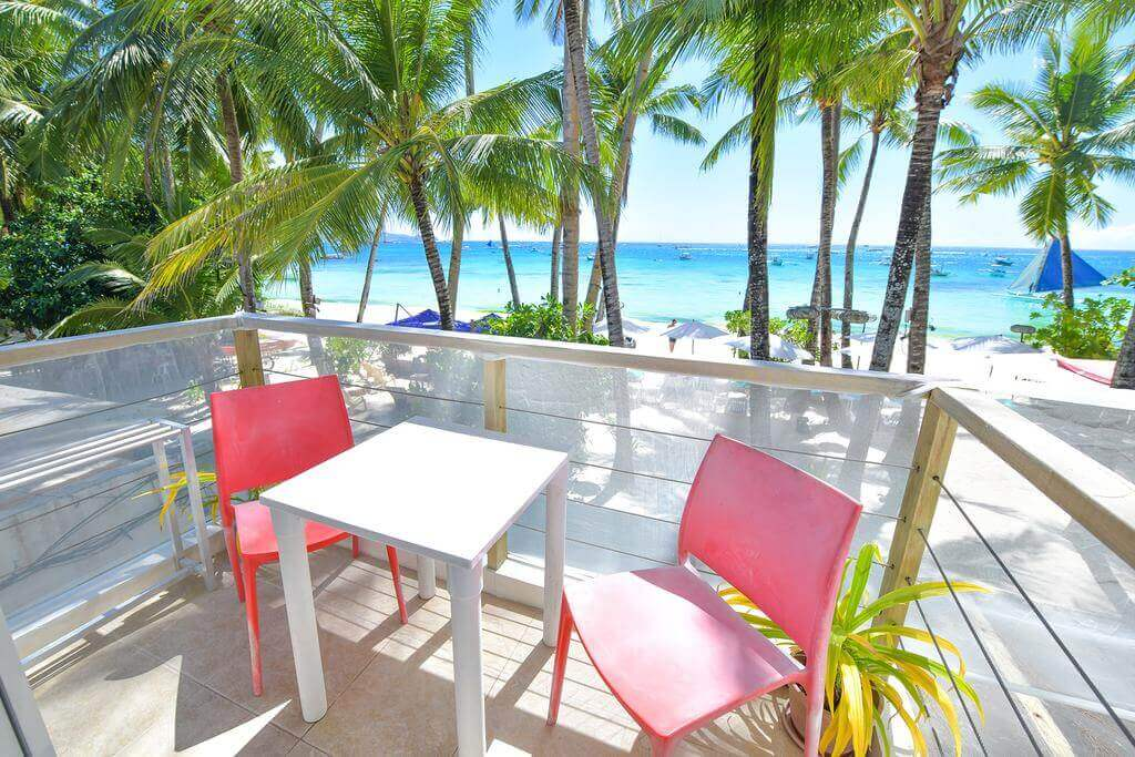 Balcony, Chairs And Tables, Coconut Trees, Beach, White Sand, Boats, OCean