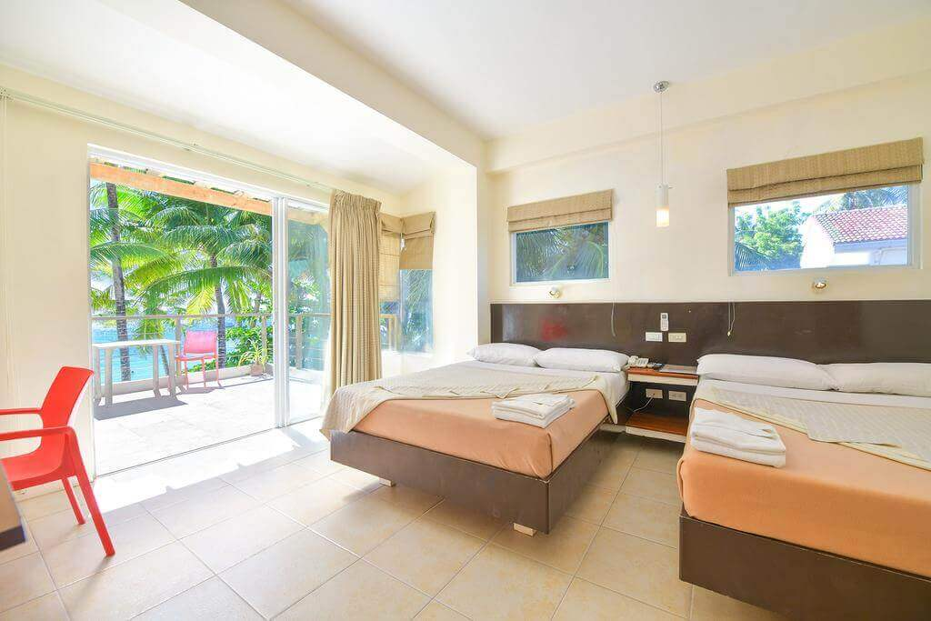 Beds, Nightstand, Chairs, Curtains, Balcony, Ocean, Coconut Trees