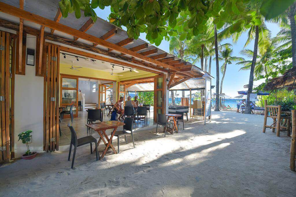 Hey Jude Front View, Tables and Chairs, White Sand, Coconut Trees, Ocean