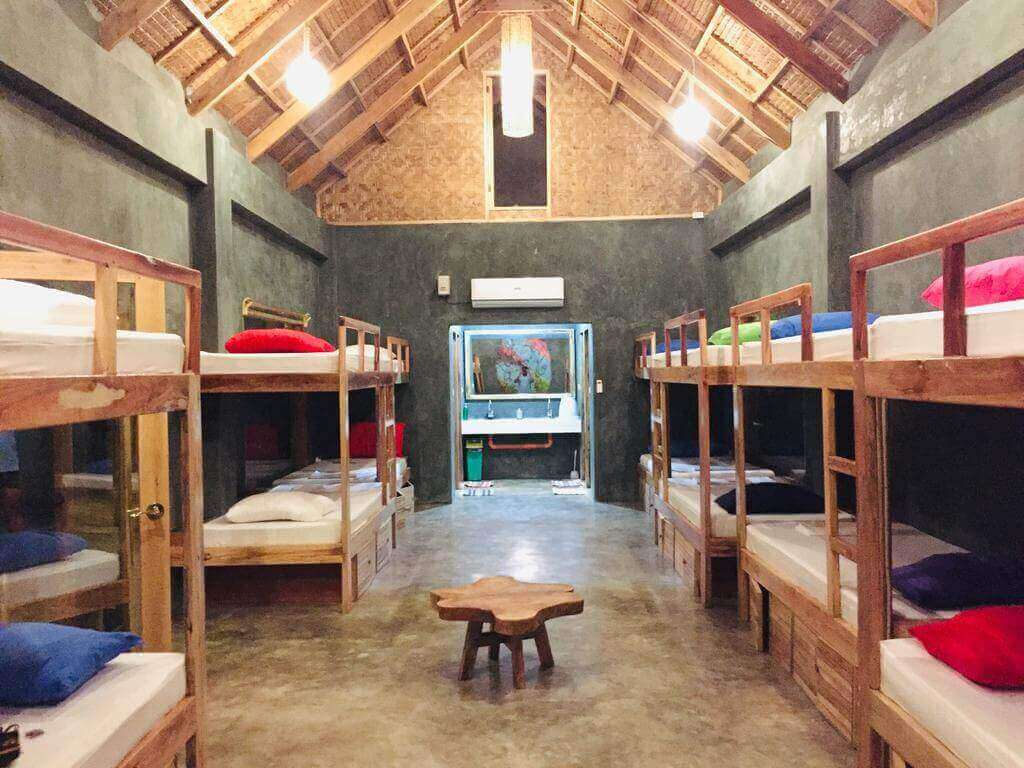 Bunkbeds, Hanging lights, chair sink, mirror, aircon