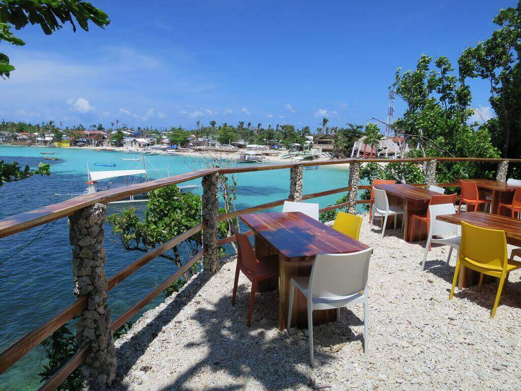 Tepanee Front View, Chairs and Tables, Oceans, Blue Sky, Island, Trees
