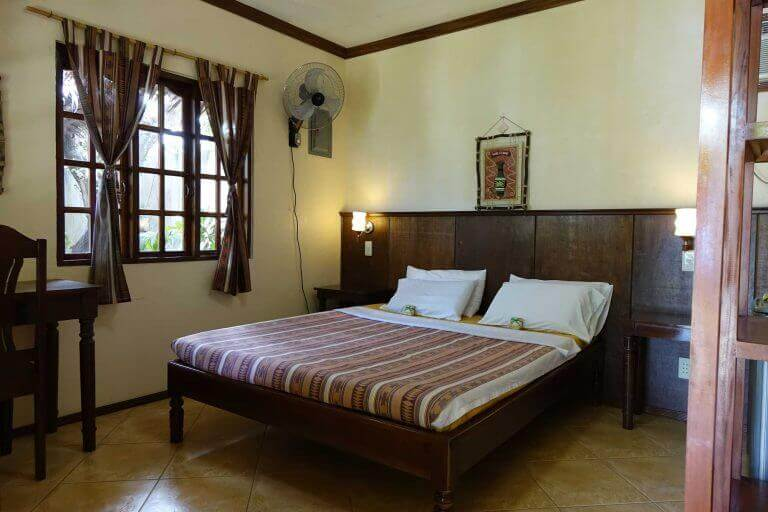 Bedroom, Beds, Picture Frame, tables and Chairs, Windows, Curtaoms, Electric Fan