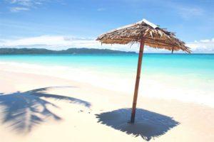 beach, clear blue waters, native hut