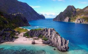island, rock formation, mountain range, blue waters, ocean