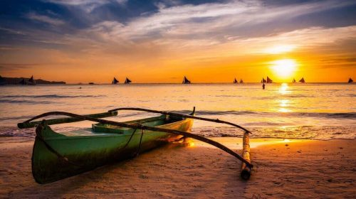 Sunset, sky, boats and silhouettes, ocean and sand
