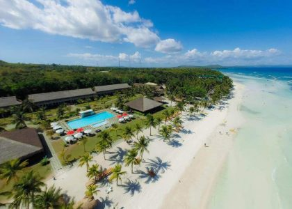 Bbc Aerial View, Trees, blue sky with clouds, white sand, clear blue ocean, coconut trees, beach houses, swimming pool