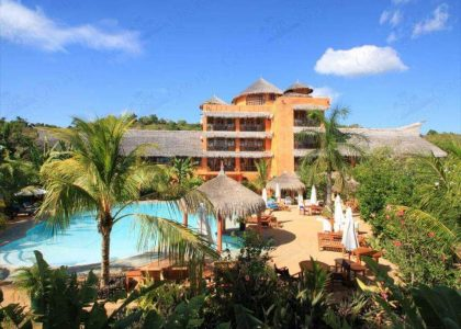 Resort, Blue sky with clouds, Swimming pool, Huts, Beach chairs and umbrellas, Coconut trees, trees,