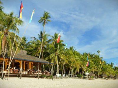 Beach Restaurant, Blue sky, Coconut trees,flags, white sand