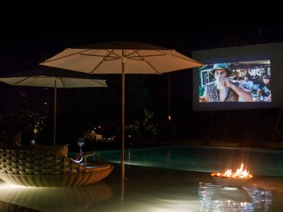 Beach chair and umbrellas, swimming pool, fire place, projector, midnight